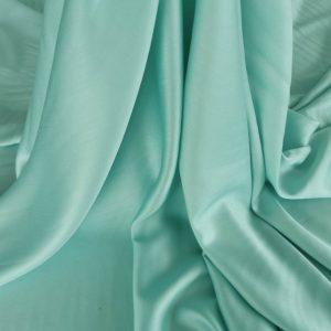 Tesatura paled turquoise din matase naturala si bumbac